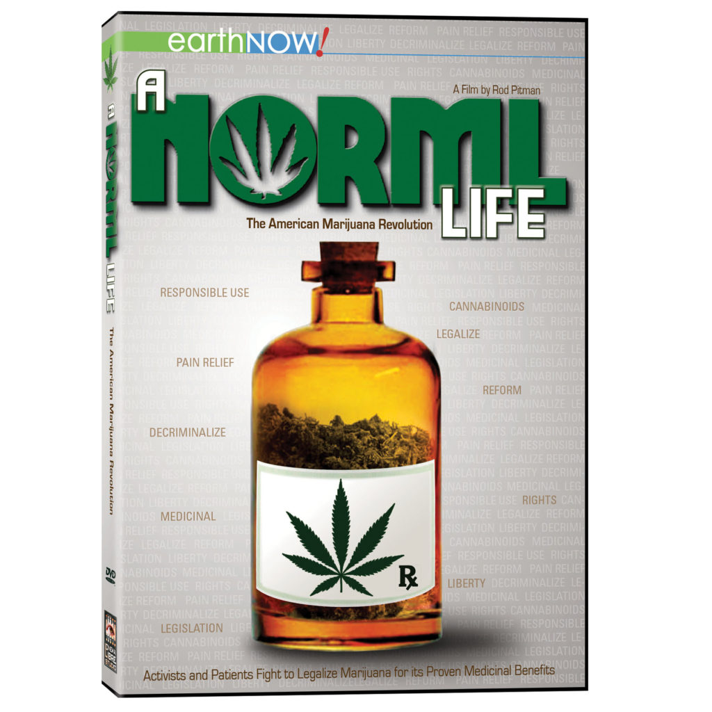 "A photograph of a DVD case featuring the film ""A NORML Life"", the text of which is written in large letters at the top. The ""O"" of the text features the negative space of a cannabis leaf. Above the title on the left of the DVD case are the words ""earthNOW!"" highlighted by green and blue. Above the title on the right is written ""A film by Rod Pitman"". Below the title reads in small brown letters ""The American Marijuana Revolution"". In the centre of the frame is a brown medical bottle filled with cannabis flower and a label featuring a cannabis leaf and the pharmaceutical Rx symbol. Around the bottle are many words related to cannabis law and product, the majority written in white on a grey background, and a few highlighted in brown. Below the bottle in small brown letters is written ""activist and patients fight to legalize marijuana for its proven medicinal benefits""."