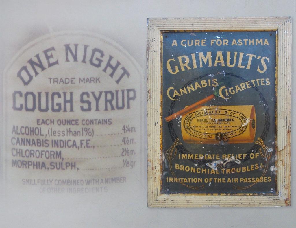 """Fotografía que muestra el antiguo Jarabe para la Tos y los cigarrillos de cannabis de Grimault. La etiqueta del jarabe para la tos dice """"One Night Cough Syrup"""" e incluye sus ingredientes: alcohol, cannabis indica, cloroformo, morfina y sulfuro. El anuncio de los cigarrillos de cannabis de Grimault muestra unos cigarrillos marrones liados, supuestamente llenos de cannabis. Debajo, se lee """"Alivio inmediato de la irritación de los problemas bronquiales de las vías respiratorias""""."""
