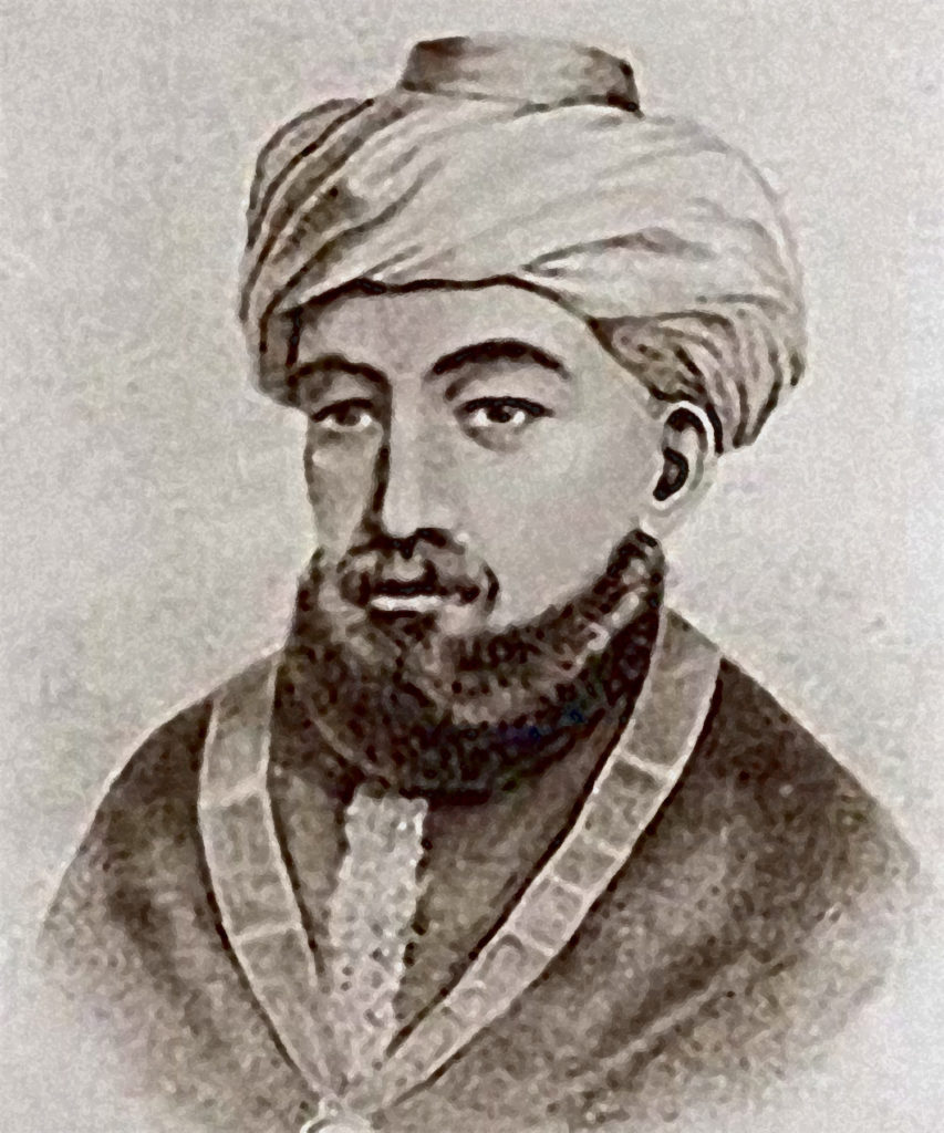 A 18th century black and white illustrated portrait of Moses Maimonides, a medieval Sephardic Jewish philosopher and scholar. He wears a white turban, beard, and an oriental dress.