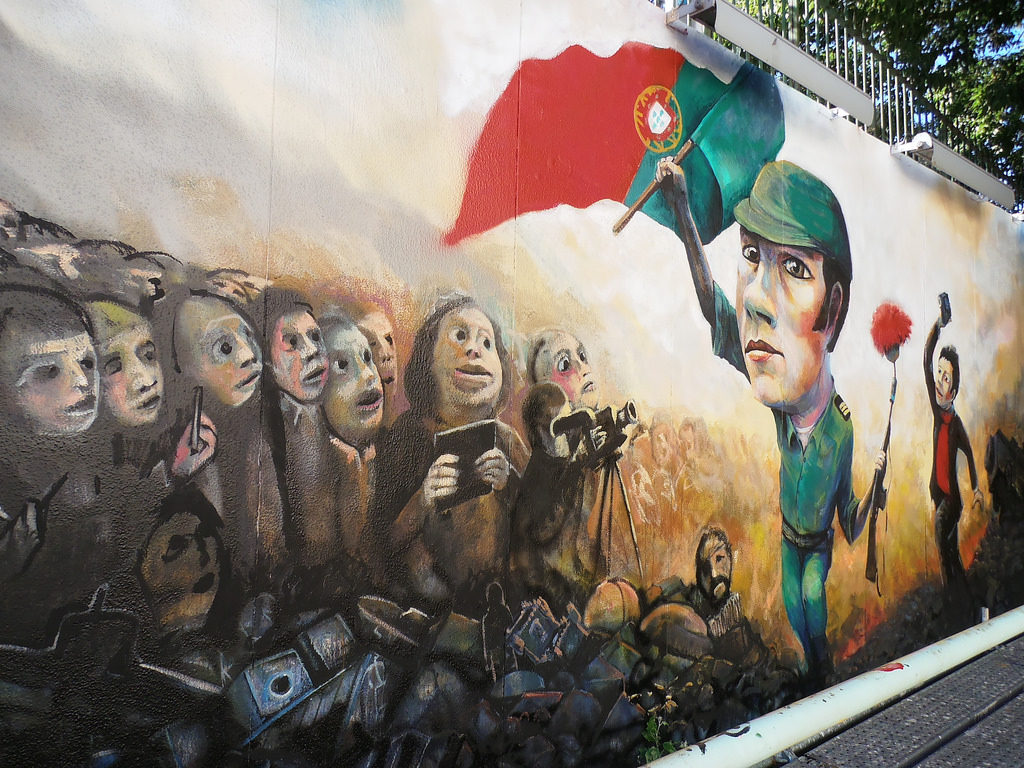 Graffiti commemorating the Carnation Revolution of 1974, which saw an end to a period of military dictatorship and ushered in a new era of social experimentation (© Jeanne Menj)