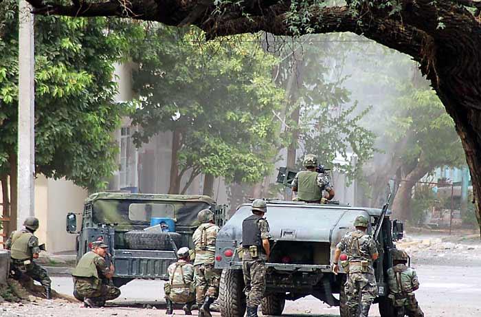 Mexikanische Soldaten bei einer Operation gegen Kartellmitglieder in Michoacan