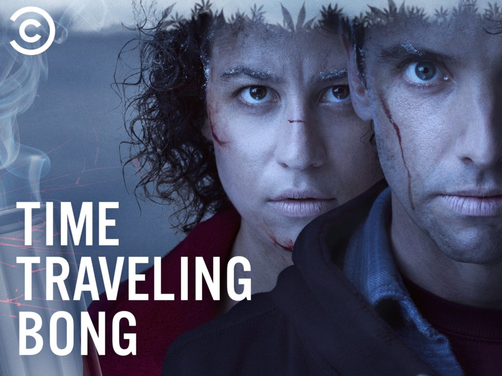 A close up photo of the faces of actors Ilana Glazer and Paul W. Downs as their characters Sharee and Jeff from the series Time Traveling Bong. They both have some small cuts on their faces, and snow in their eyebrows. In the bottom left corner are the words 'Time Traveling Bong'.