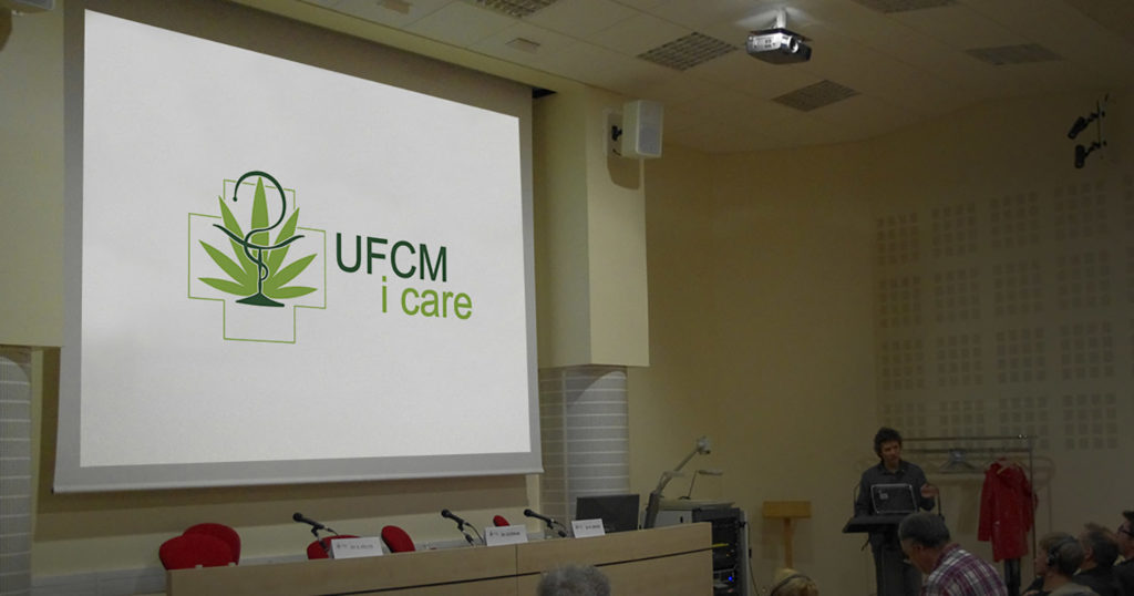 A photograph of the UFCM icare symposium panel area, sponsored by Sensi Seeds