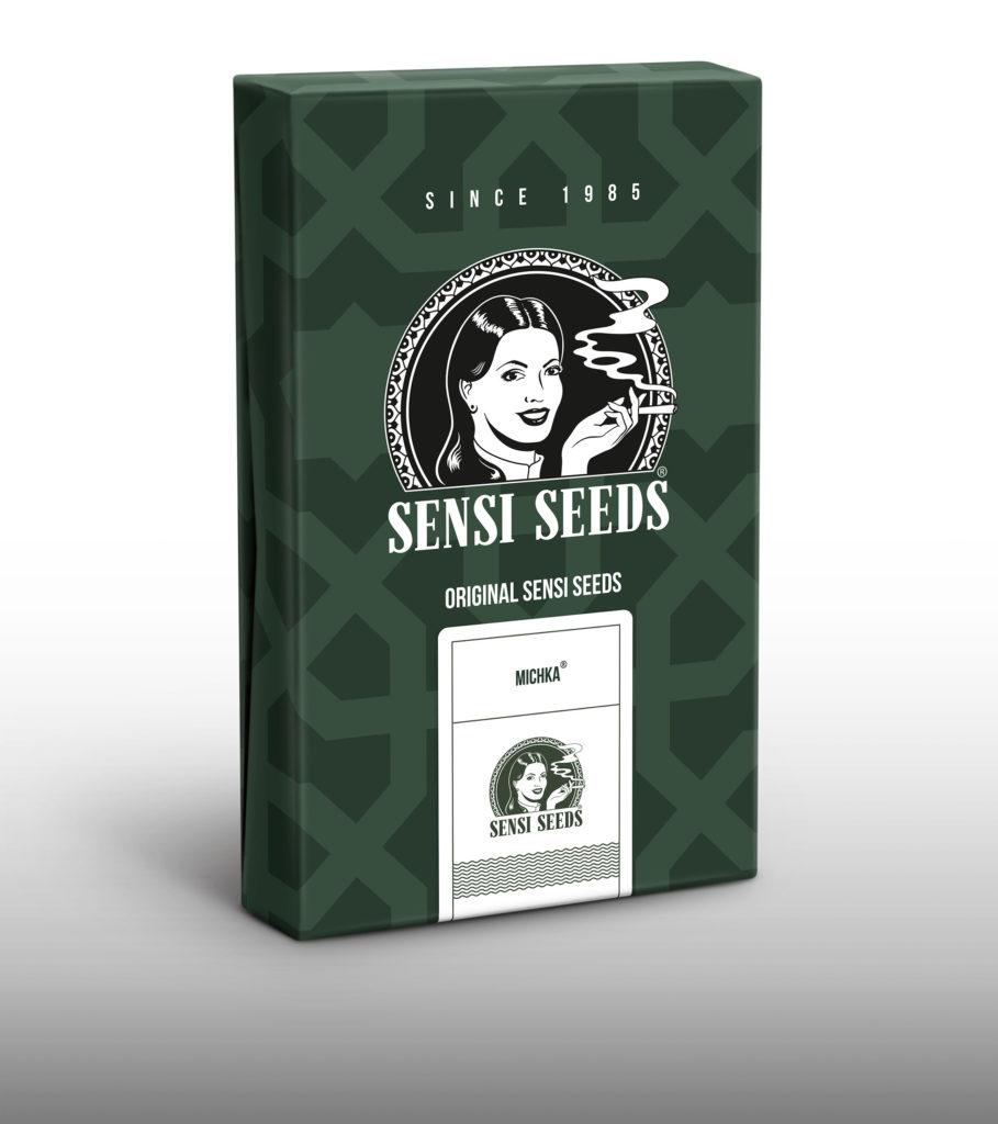 Een foto van een pakje Michka reguliere cannabiszaden op een witte achtergrond. De Michka verpakking is groen.