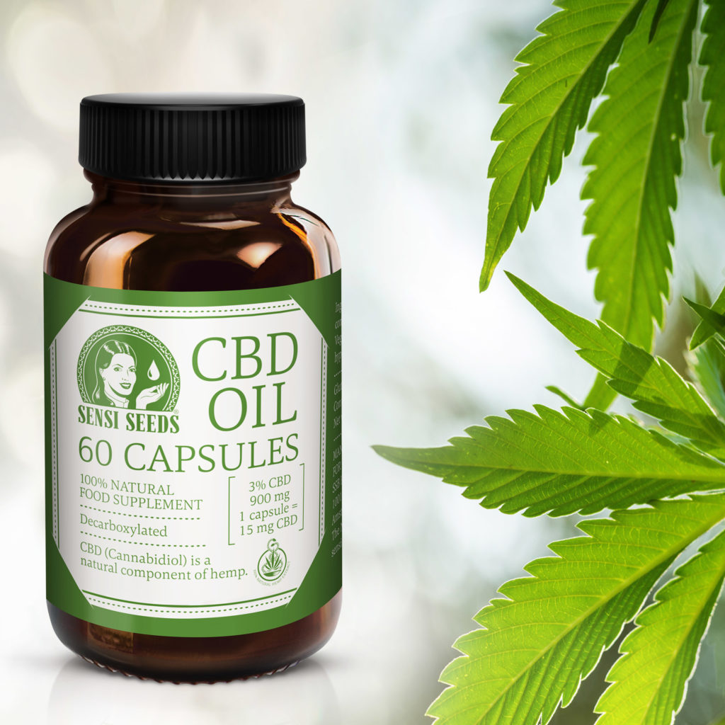 Product photo of CBD oil from Sensi Seeds. A brown bottle of CBD capsules is superimposed into a white space besides a cannabis plant. CBD Oil 60 Capsules is written in large type, alongside the Sensi Seeds logo. The colour scheme is entirely white and green. On the bottom of bottle we can see written that it is a a 100% natural, decarboxylated food supplement and that the average CBD content is 3%, totalling 900 mg, and 1 capsule =15 mg CBD.