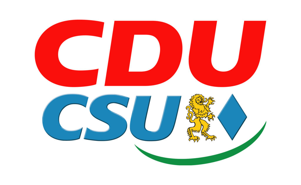 In the photo we see the logos of two German political parties. At the top is the red CDU (Christian Democratic Union) logo, and below that is the blue logo for the CSU (Christian Social Union in Bavaria).