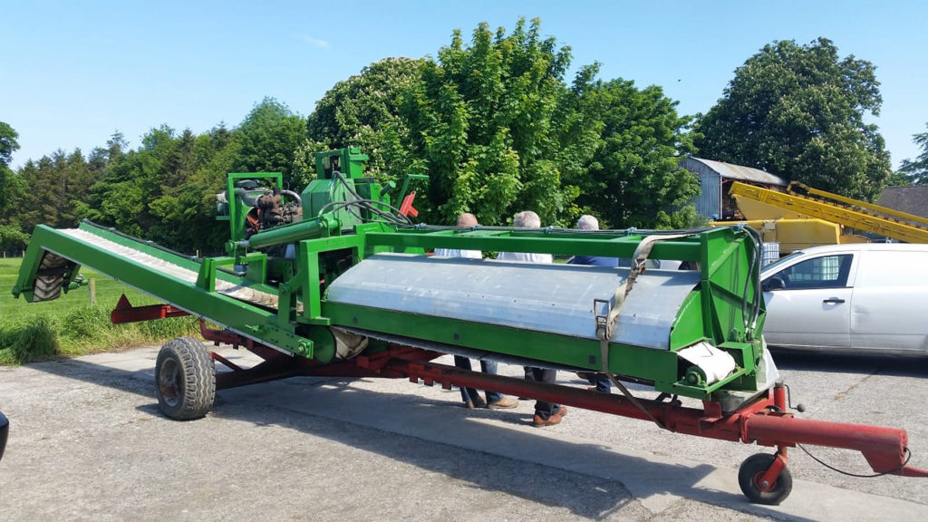 Photo of agricultural machinery. It seems to be a type of leaf stripper.