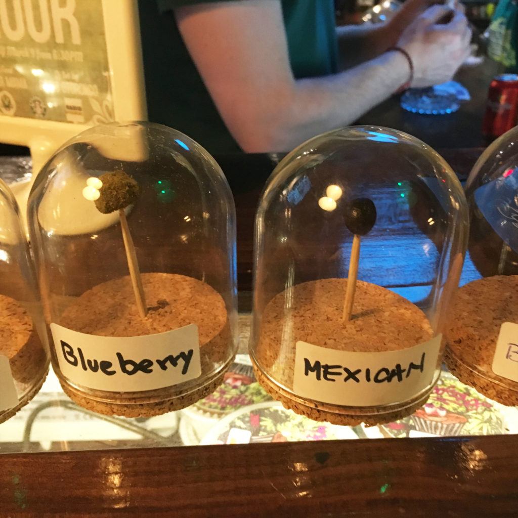 "Photo of two glass jars with ""Blueberry"" and ""Mexican"" written on them."