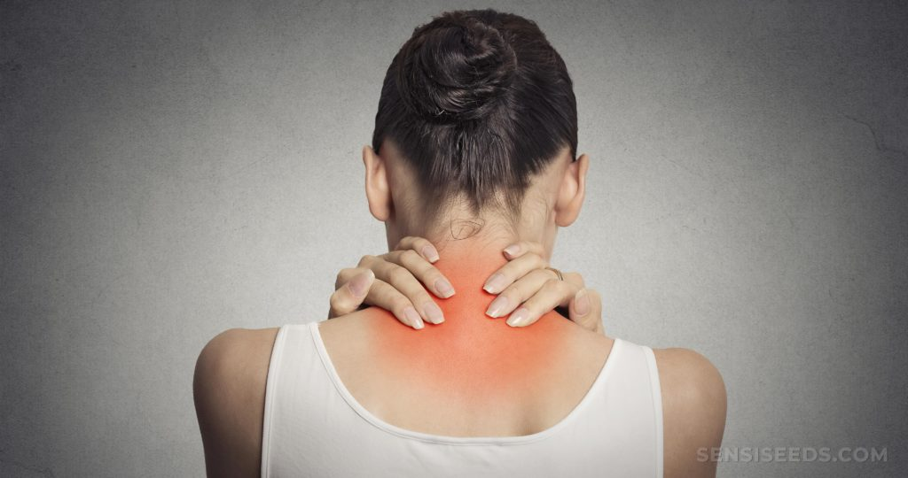 A woman holding her neck which is red and inflamed