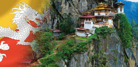 The Bhutan flag and a building up on a mountain