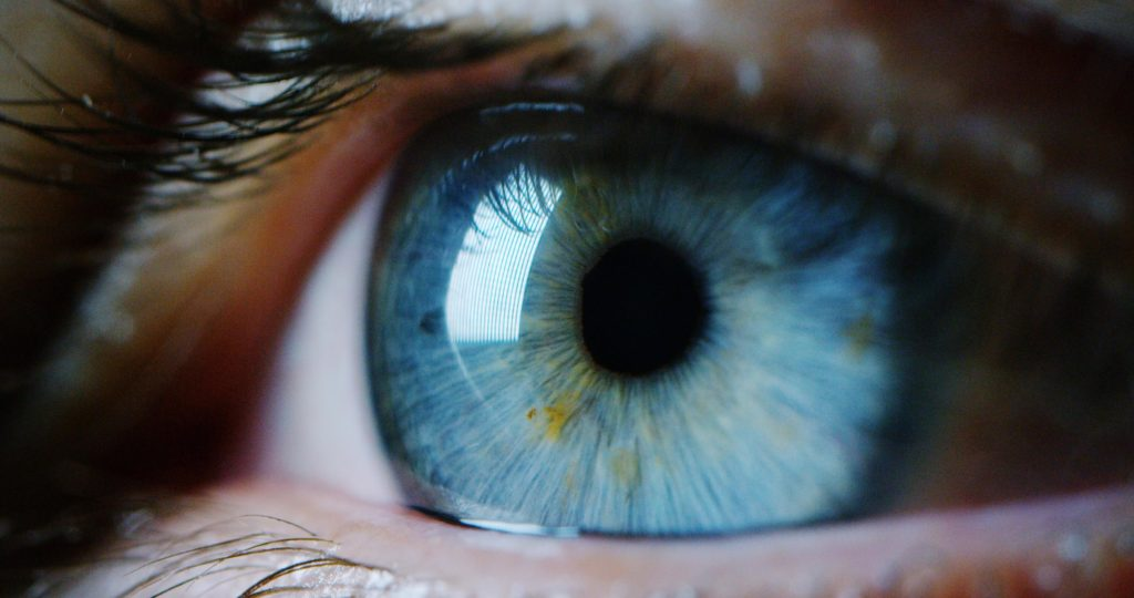 A close-up of a person's blue eye