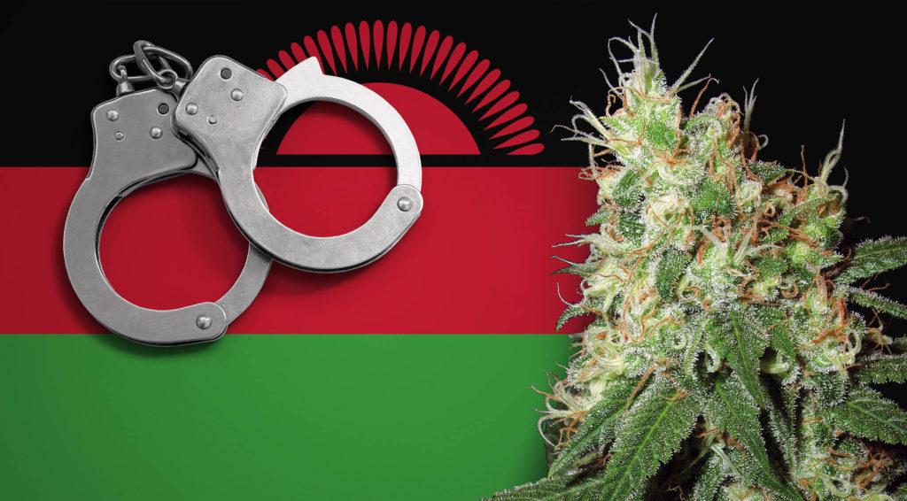 The Malawi flag, a pair of handcuffs and a cannabis plant
