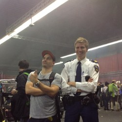 Vendor and policeman inside the Cannabis Cup venue (photo by DNA Genetics)