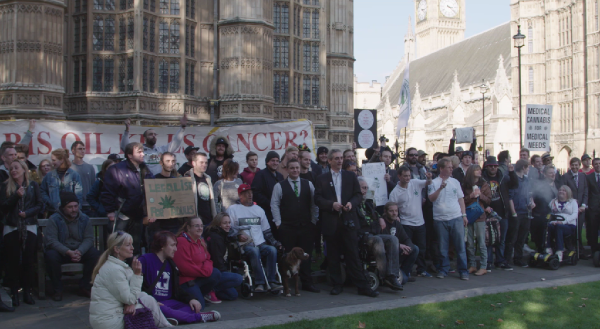 Hundreds of people protesting near the British Parliament for the legalization of cannabis